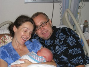 A Picture of my newborn daughter, Ann Katherine Tyler, with Mom and Pop